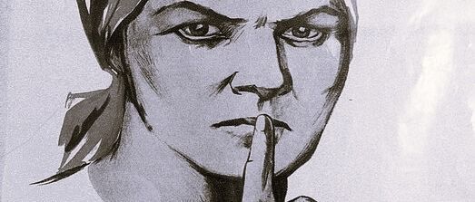 Image of a woman holding her finger to her mouth to indicate: be quiet